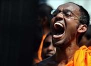 protest-buddhist_monk_sri-lanka-e1335055142179