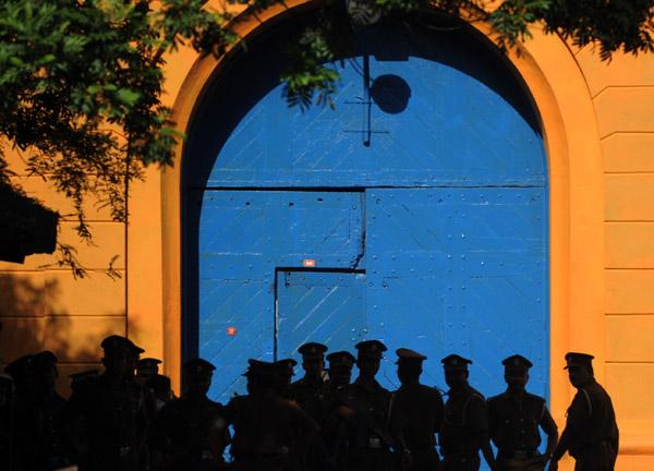 Sri Lankan policemen stand guard over prison