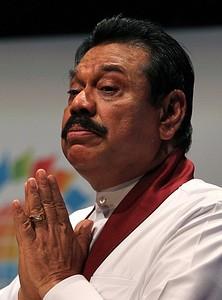 Sri Lanka's President Mahinda Rajapaksa delive...