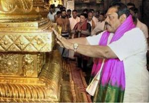 Sri Lankan President Mahinda Rajapaksa offering prayers at the Lord Venkateswara temple at Tirumala in Tirupati on Saturday.— PHOTO: PTI