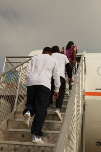 Asylum seekers board a plane from Christmas Island back to Sri Lanka.