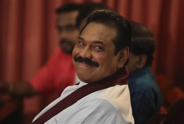 Sri-Lankan-President-Mahinda-Rajapaksa-reacts