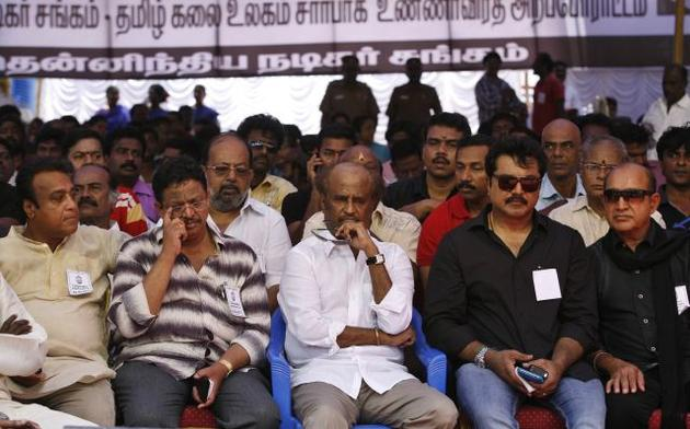 Tamil movie stars including superstar Rajnikanth, center, sit during a day long fast in Chennai demanding probe into alleged wartime abuses by Sri Lanka. The stars are fasting for a day to protest what they say is the mistreatment of ethnic Tamils in neighbouring Sri Lanka and to demand an international probe into alleged wartime abuses there. A U.N. investigation into the final months of the war indicated that the ethnic Sinhalese-dominated government might have killed as many as 40,000 Tamil civilians. Photo: AP