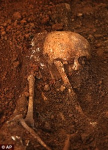 Judicial medical officer Asoka Jayasena carries a skull of an unearthed skeleton. The country has seen two major uprisings from Marxist guerrillas