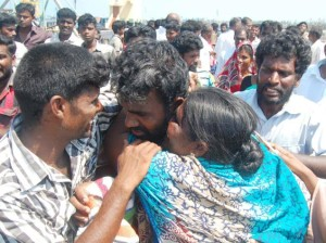 This April 12, 2013 photo shows an emotional reunion at a Rameswaram fishing jettly where a batch of fishermen arrived after their release from Sri Lanka. On Wednesday, India formally raised the issue of its fishermen languisihing in Sri Lankan jails.