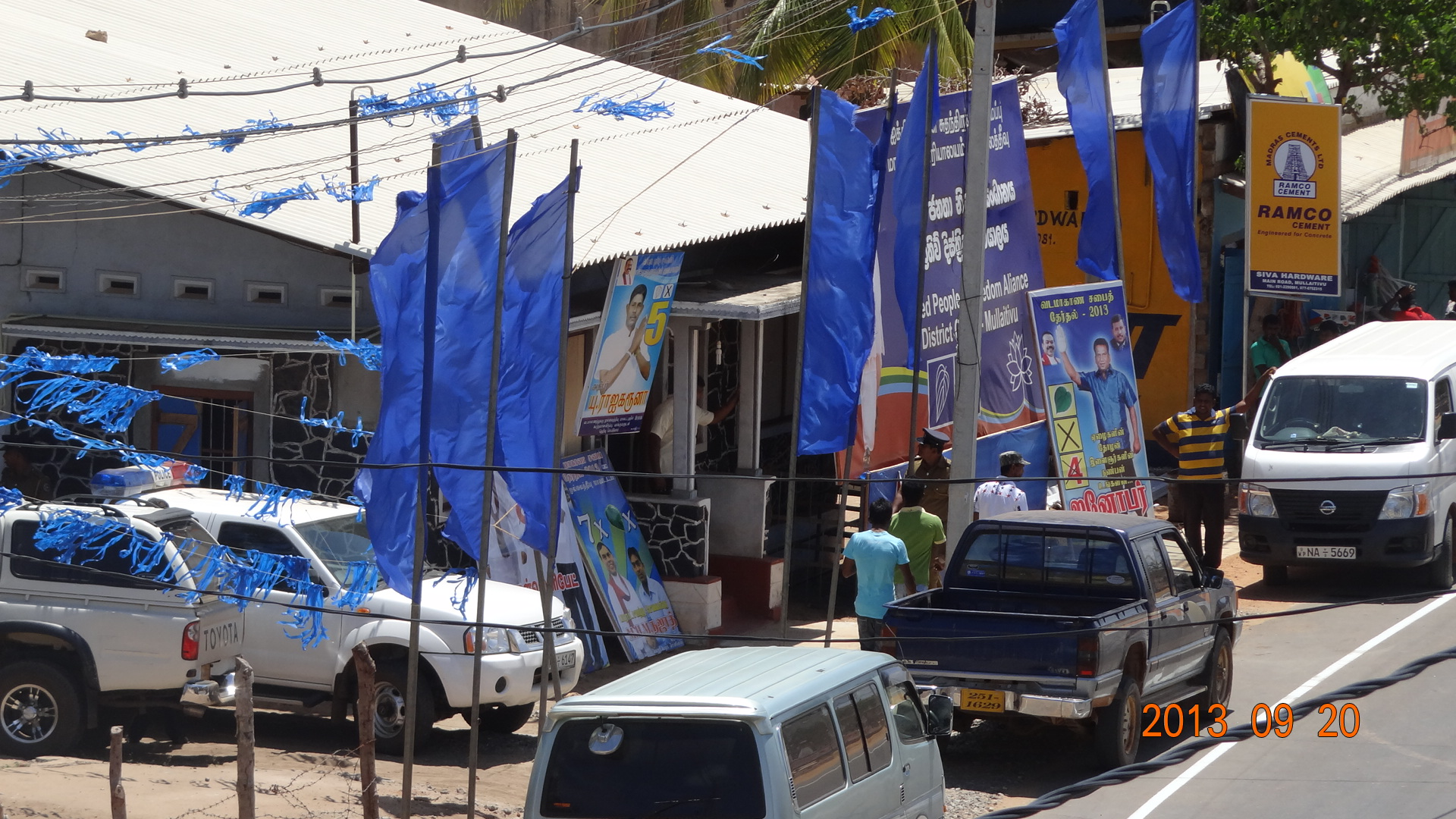 Police vehicle parked at the UPFA office and policeman outside meeting at UPFA office in Mullaitivu
