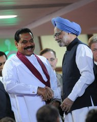 Manmohan Singh, right, prime minister of India with Mahinda Rajapaksa, president of Sri Lanka, during the Commonwealth Games closing ceremony in New Delhi, on Oct. 14, 2010.