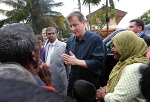 British Prime Minister David Cameron talks to villagers of an IDP camp in Jaffna on Friday.
