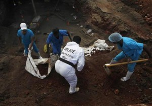Police officers and doctors dig up skeletons at a construction site in the former war zone in Mannar