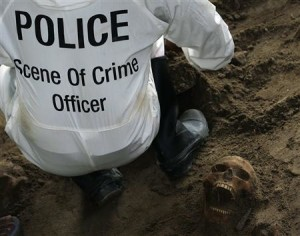 A police officer works next to a human skull at a construction site in the former war zone in Mannar