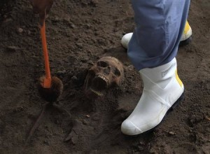 A police officer excavates a human skull at a construction site in the former war zone in Mannar