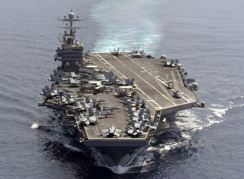 Iranian-boats-shadow-US-ship-in-Gulf-7G108FRV-x-large