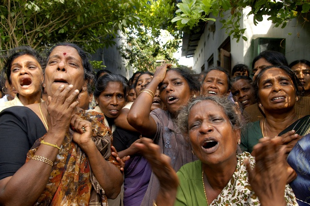 Relatives of the slain French aid group Action Contre La Faim's local staff mourn during their funeral procession near Trincomalee, Sri Lanka. © Reuters 2006