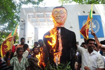 Sri Lankan National Freedom Front activists burn an effigy of UN secretary-general Ban Ki-moon during a protest rally in Colombo on July 6, 2010. (Credit: AFP)