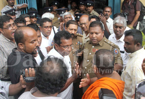 HR lawyer J.C. Weliamuna, who  rushed to the meeting venue, talking to the monks and mob