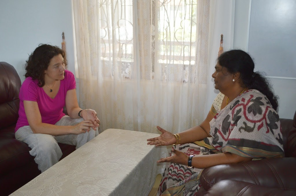 Laura Davies  in a discussion with Batticaloa District GA Mrs. PSM Charles in the GA office