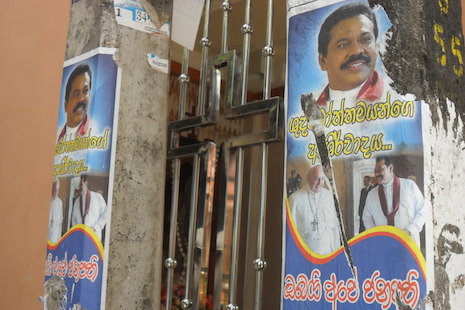 An presidential election campaign poster in the Kochchikade area of Colombo features Pope Francis and President Mahinda Rajapaksa (Photo by ucanews.com)