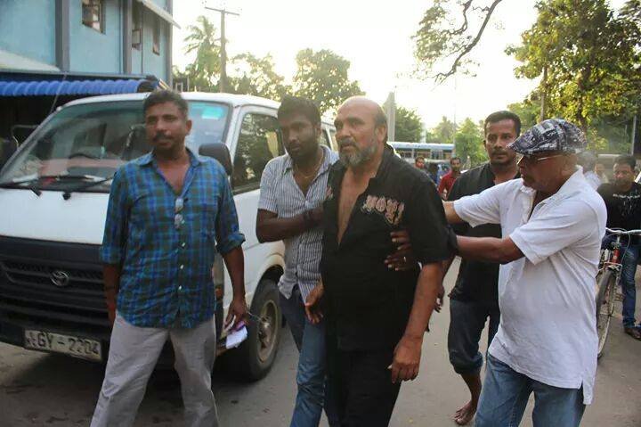 Jayathilaka Bandara, (in black shirt) Sampath Samarakoon (in the back) after the assault