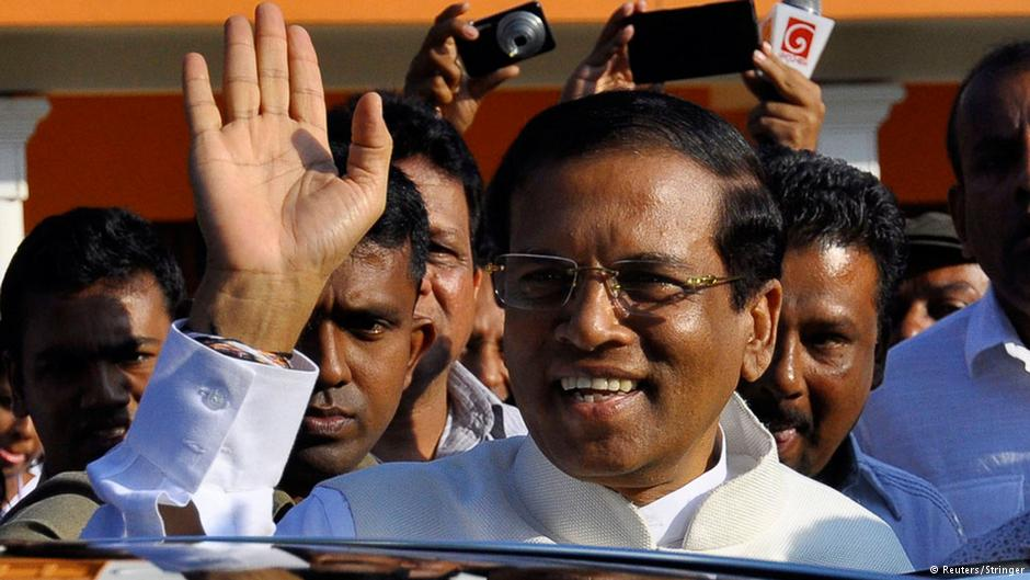 Presidential candidate Mithripala Sirisena waves at his supporters as he leaves after casting his vote for the presidential election in Polonnaruwa January 8, 2015 (Photo: REUTERS/Stringer)