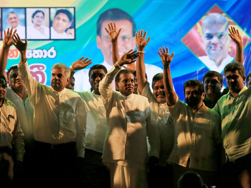 Sirisena and other top opposition leaders wave to their supporters during the final election rally before the vote (Buddhika Weerasinghe/Getty Images)