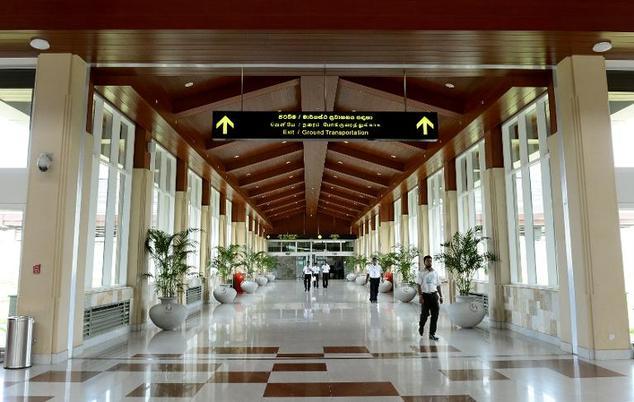 A Workers walk through a corridor at the international airport at Hambantota ©Lakruwan Wanniarachchi (AFP/File)