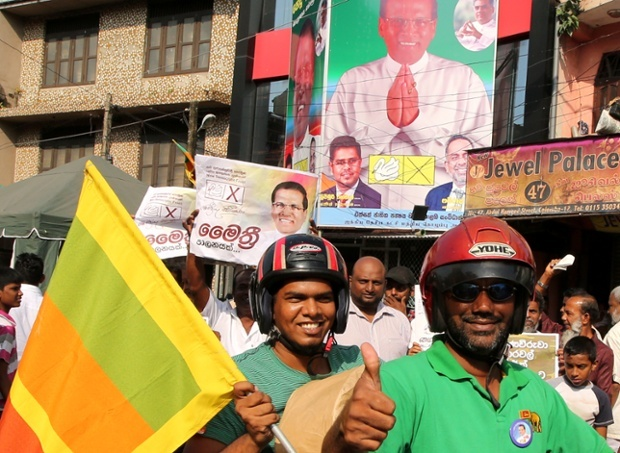 Supporters of Maithripala Sirisena celebrate their leader's victory in Colombo, Sri Lanka. Photograph: Buddhika Weerasinghe/Getty Images
