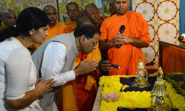 President Maithripala Sirisena and his wife, Jayanthi Sirisena, look at a case believed to hold a relic of Lord Buddha, at a temple in Bodh Gaya, India. Photograph: Manish Bhandari/AP