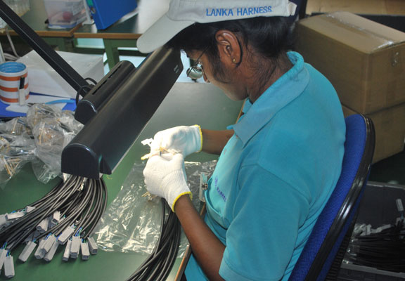 Workers at Lanka Harness, a Sri Lankan exporter of vehicle safety devices. Credit: Rohan Gunasekera