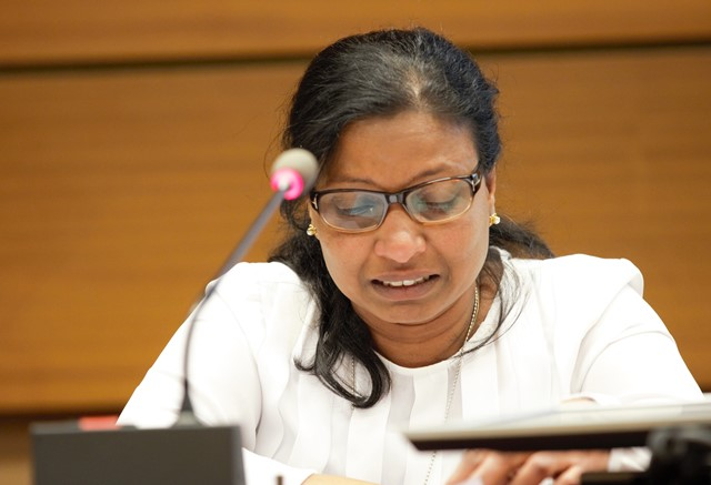 Pilidevan's wife making her statement at the side event