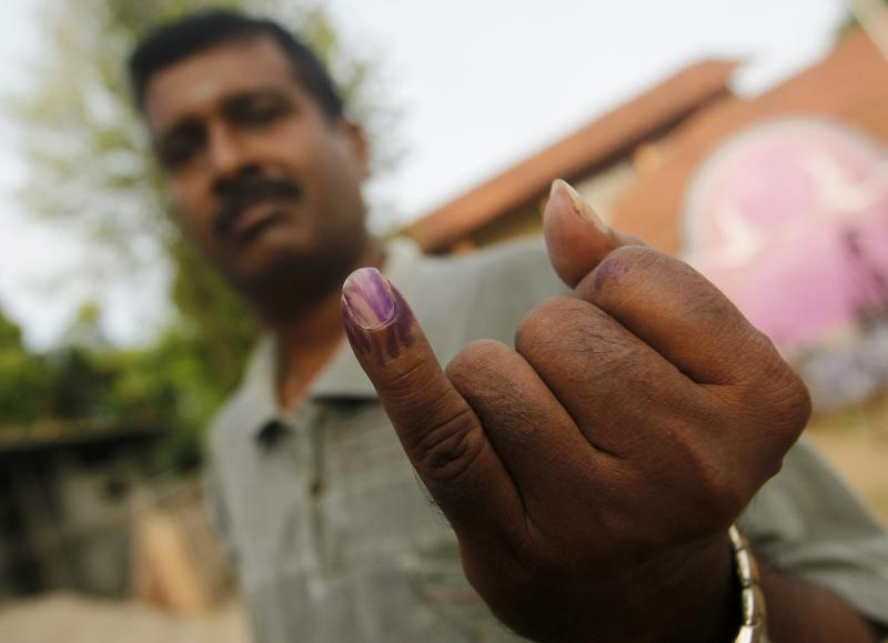 A Tamil man shows his ink-stained finger after casting his vote at a polling station during the first provincial polls in 25 years in Jaffna, a former war zone in northern Sri Lanka, September 21, 2013. Dinuka Liyanawatte / Reuters