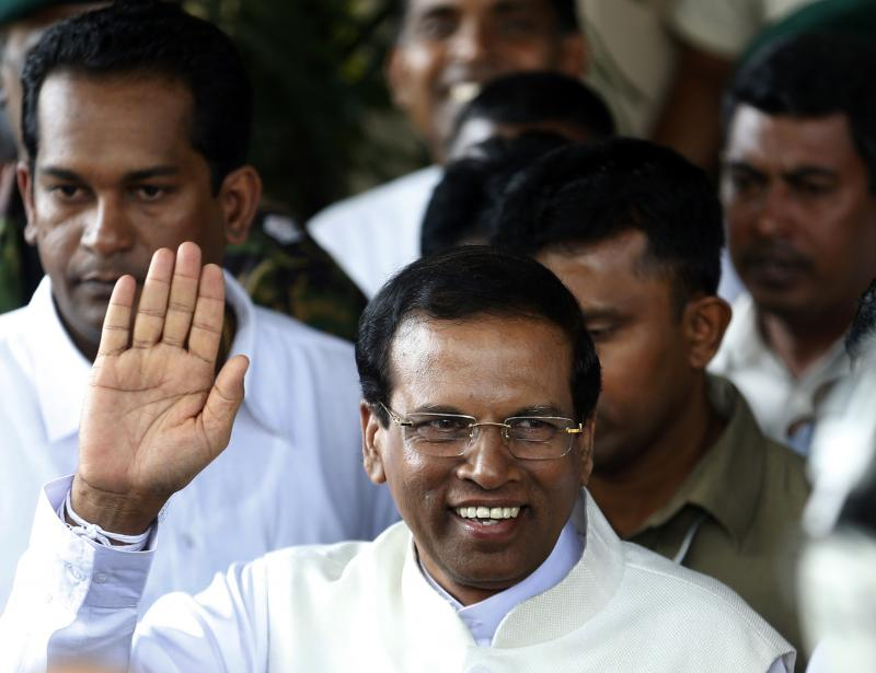 Sri Lanka's newly elected president Mithripala Sirisena waves at media as he leaves the election commission in Colombo, January 9, 2015. Dinuka Liyanawatte / Reuters