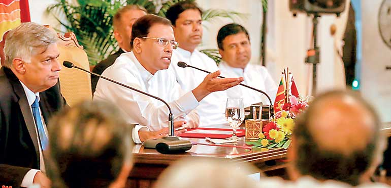 (President Maithripala Sirisena gestures during his meeting with newspapers and media editors and owners yesterday. Prime Minister Ranil Wickremesinghe is also present )