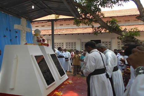 This May file photo shows Father Manuelpillai Sarathjeevan being honored. He died of a heart attack as he was accompanying Tamil refugees out of the conflict zone during the final days of Sri Lanka's civil war in 2009. (Photo by Quintus Colombage)