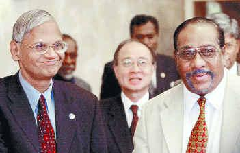 G. L' Peiris with LTTE theoretician Anton Balasingham ( File photo)