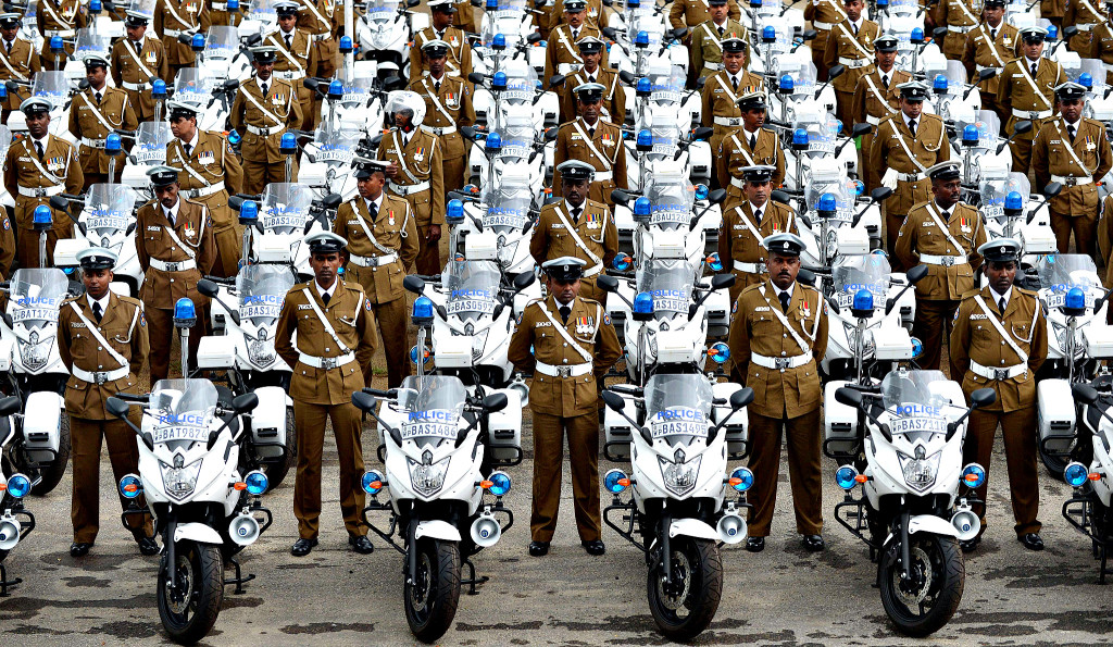 Sri Lankan policemen stand next to their...Sri Lankan policemen