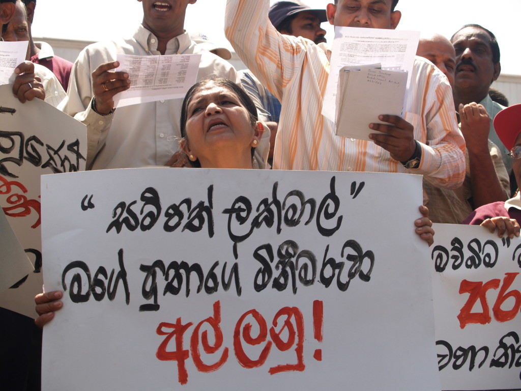 FMM photo: Lakmal's mother holding the above placard