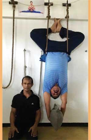 Rajapksa standing on his head!