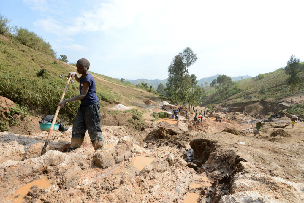 A child separates mineral from rock and sand at a mine in DR Congo (Picture: AFP/Stringer)
