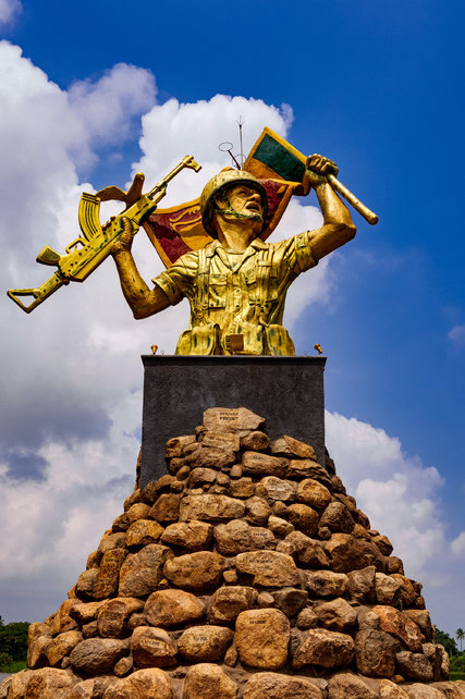 The Victory Monument at Puthukkudiyiruppu, featuring a Sri Lankan soldier in full battle gear with a Sri Lankan flag and an assault rifle. Credit Poras Chaudhary for The New York Times