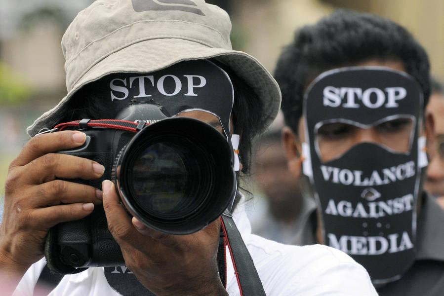 Sri_Lankan_photojournalist_wears_a_slogan_emblazoned_m_13038a9c4f