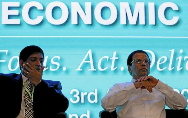 "Sri Lanka's President Sirisena looks on next to Karunanayake Minister of Finance during the ""Sri Lanka Business Forum"", in Colombo"