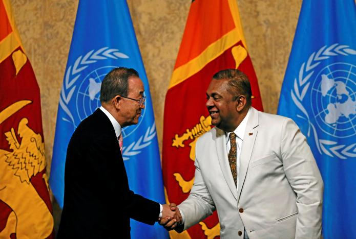 """United Nations Secretary-General Ban Ki-moon shakes hands with Sri Lanka's Minister of Foreign Affairs Mangala Samaraweera at the """"Sustaining Peace - Achieving Sustainable Development Goals"""" forum during an official visit  in Colombo"""