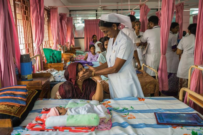 A nurse greets a mother in the maternity ward of Jaffna Teaching Hospital. In 1987, during the civil war, Indian soldiers who were in Sri Lanka as peacekeepers killed more than 60 patients and staff. Today the hospital has returned to normalcy and is a place where people of all ethnicities and religions are treated.