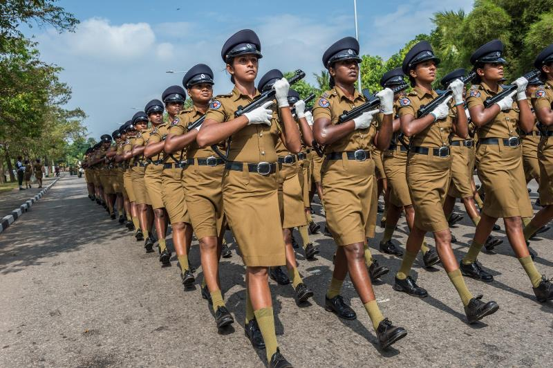 "An all-female unit of police officers practices marching for the 67th Independence Day celebration in Colombo. In his speech on February 4, 2015, the new president, Maithripala Sirisena, said the country's biggest challenge was ""bringing together the minds of the people of the north and south"" to ""take our great motherland forward as a land rich in human affection and understanding."""