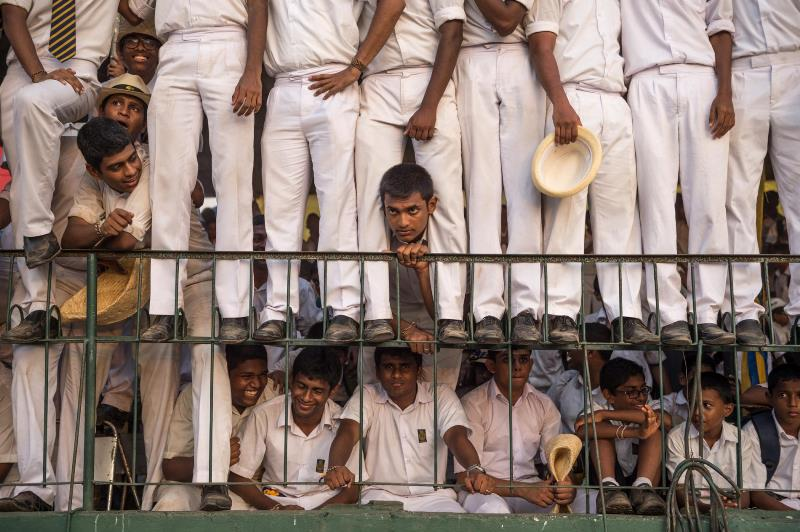 Uniformed students from Royal College watch the school's 137th annual cricket match against archrival S. Thomas' College. A Colombo tradition, it's known as the Battle of the Blues, after the most prominent color on the school flags.