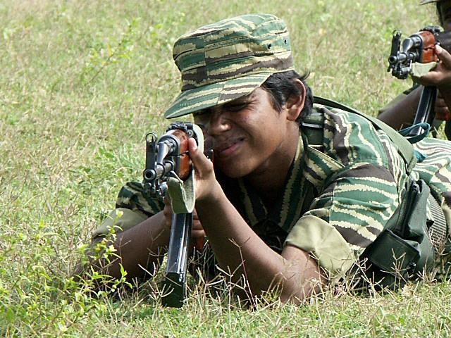 August 2004: A female Tamil Tiger fighter during training.Amantha Perera