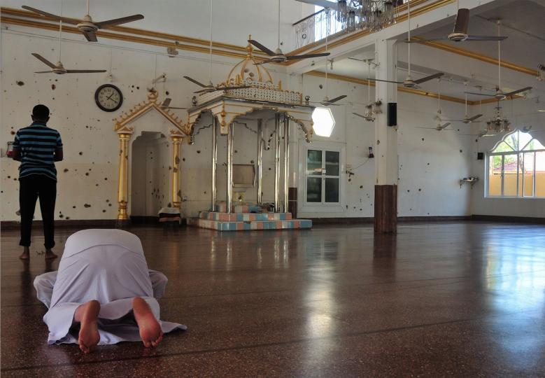 Amantha Perera Bullet-splattered walls at the Katankuddi mosque. by Amantha Perera.