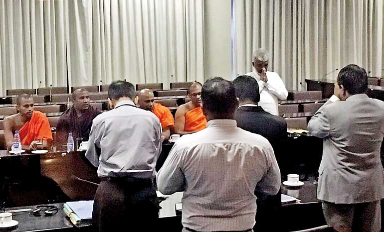 Even as calls mount for the arrest of Gnanasara Thero over his remarks about Razik's arrest and threats to annihilate Maligawatte, the monk breezed into Parliament on Tuesday (22) for an audience with Minister for Buddha Sasana and Justice Wijeyadasa Rajapakshe/ ft'lk photo