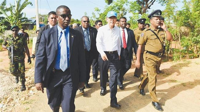 UN Secretary General Ban Ki-moon, center clad in white, visits war-battered Tamil areas in Sri Lanka on September 2, 2016. (Photo by AFP)