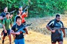 Sri Lanka Rugby team, led by President's sons practice mechine gun exercises